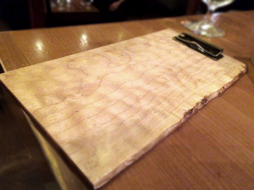 menu board with brass clip