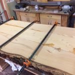 fir live edge table top being made